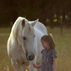 What do you have by Giselle Pierce - Babies & Children Children Candids ( child, little girl, girl, grass, horse, friendship, children, gelding, animal, kid )