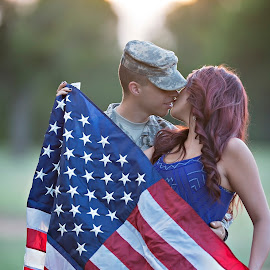 Home coming by Carole Brown - People Couples ( soldier, kissing, flag, red hair, couple )