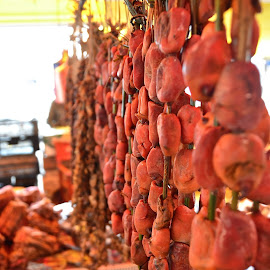 Meat hanging in market by Tyrell Heaton - Food & Drink Meats & Cheeses ( chile, market, valdivia, feria fluvial, meat )