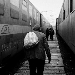 //// by George Mihes - People Street & Candids ( beggar, black and white, station, satchel, white, train, back, man, black,  )
