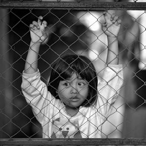 Let me free by Juang Rahmadillah - Babies & Children Children Candids ( indonesia, street, children, candid, blackwhite )