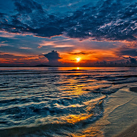 The morning sun - Changi Beach . Singapore by John Chung - Landscapes Travel