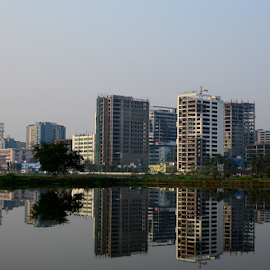 Building reflection by Anindya Karmakar - Landscapes Travel ( water, building, reflection, sky )