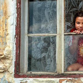 The girl in the window by Mirela Savu - City,  Street & Park  Street Scenes ( girl, village, window, street, innocence, romania, daia, mures,  )