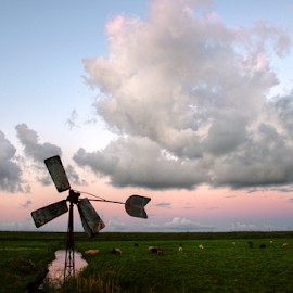 Broken wing by Mike Bing - Landscapes Cloud Formations ( clouds, archimedes, sunset, northsea, holland, petten, hondsbossche zeewering, pink, beach, windmill, fields )