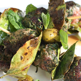 Pistoued Lamb Brochettes with Bay Leaves and Seared Olives