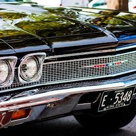 Old Chevrolet by Darrell Bruggeman - Transportation Automobiles ( novice, street, reflections, chevy, hawaii, black )
