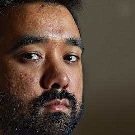 Rivetting by Ashok Borkakoti - People Portraits of Men ( sombre, stare, dark, beard, quiet, portrait, man, gloomy, steady,  )