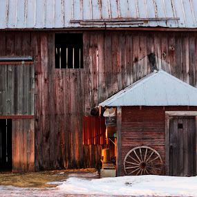 Last light by Jarrod Kudzia - Buildings & Architecture Decaying & Abandoned ( farm, winter, wood, barn, sunset, snow, wagon wheel, door )