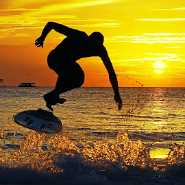 skimboarding @ sunset by Dan Baciu - Sports & Fitness Other Sports ( skimboard, extreme sports, ski, extreme, silhouette, skimboarding, kiteboarding, surfing, kiting, sunsets, sunset, boracay, surf, philippines, snowboarding )