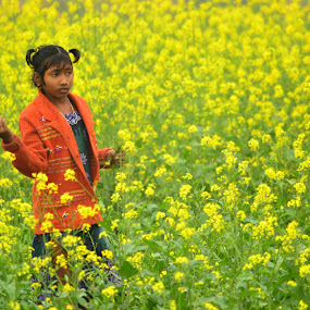 lost into dreamland by Jayanti Chowdhury - People Street & Candids ( village life, mustard field, girl, candid, portrait )