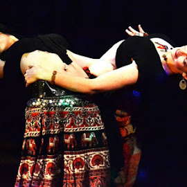 Adriana Jones, (left) and Joy Hearten-Johnson perfrom a Tribal Fusion bellydance. by Joe Coleman - People Musicians & Entertainers
