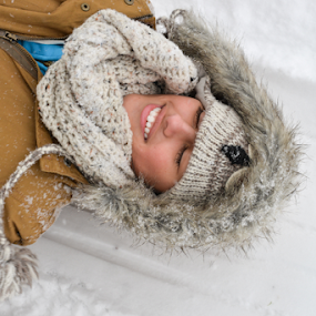 Girl laying in the snow by Kevin Pastores - People Portraits of Women