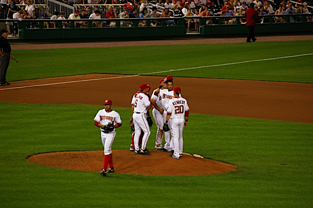 Infield hanging out at the mound