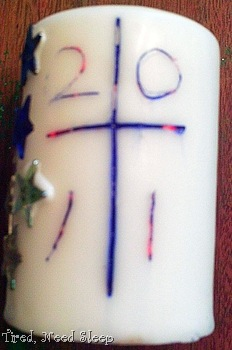 paschal candle  - cross and year