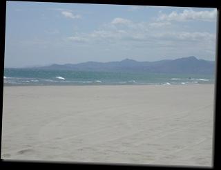 sand sea mountains and sky-glazgow