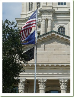 US, KS, and POWMIA flags
