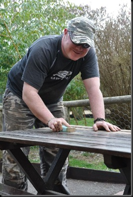Kris sanding down patio tables