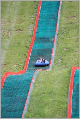Landon tubing down the mountain