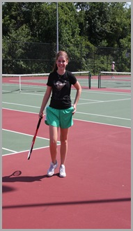 Zoe at tennis lessons, 2009