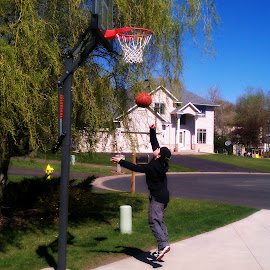 Dj practice lay up by Dawn Moder - Sports & Fitness Basketball ( basketball, ball, sunny, basket, trees, house, boy, outside )