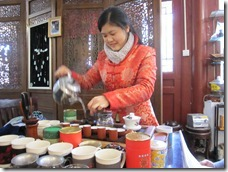 A girl preparing cineese tea