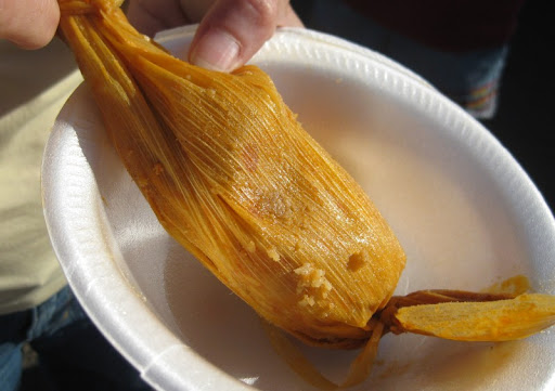 A tamal waiting to be unwrapped