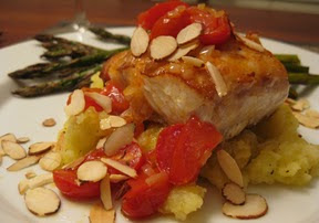 Roasted Halibut with Crushed Potatoes, Almonds and Tomatoes