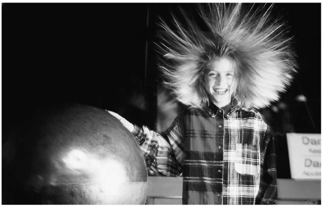 A common form of field ionization is static electricity. Here, a girl places her hand on a static electricity generator.