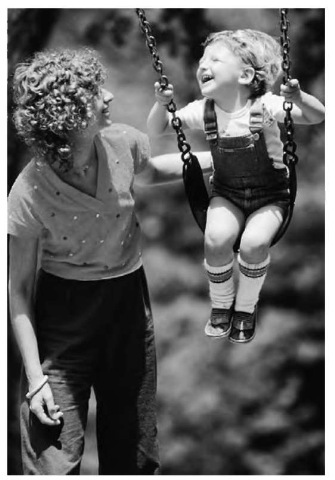 A common example of resonance: a parent pushes her child on a swing.