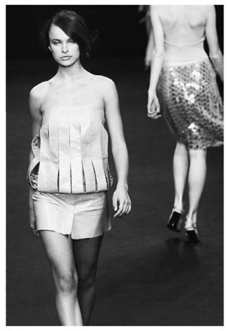 it is virtually impossible for a person in modern America to spend an entire day without coming into contact with at least one, and more likely dozens, of plastic products, all made possible by organic chemistry. Here, a fashion model parades a dress made of PVC.
