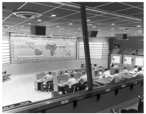 A reconstruction of the Mercury Control Center at Kennedy Space Center shows the world map with the ground tracks and station coverage.This figure is available in full color at http://www.mrw. interscience.wiley.com/esst.