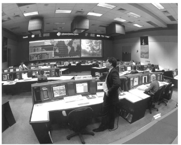 The Control Room in Building 30S layout is functionally very similar to the earlier MCC (shown here for Shuttle operations). The Flight Director's console is typical of the new MCC, and it features CRT displays with color graphics and a digital intercom control panel This figure is available in full color at http://www.mrw.interscience.wiley.com/esst.