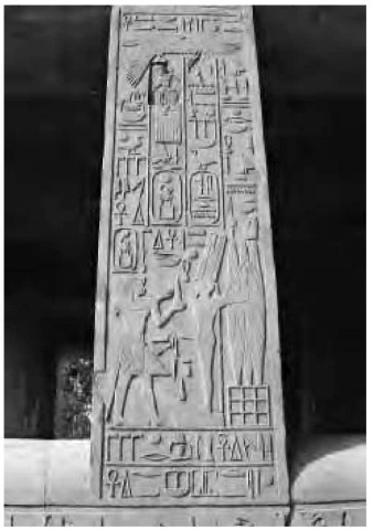 A column from the White Chapel, built at Karnak by Senwosret I of the Twelfth Dynasty. The hieroglyphs depict the pharaoh honoring the god Min with battle treasures.