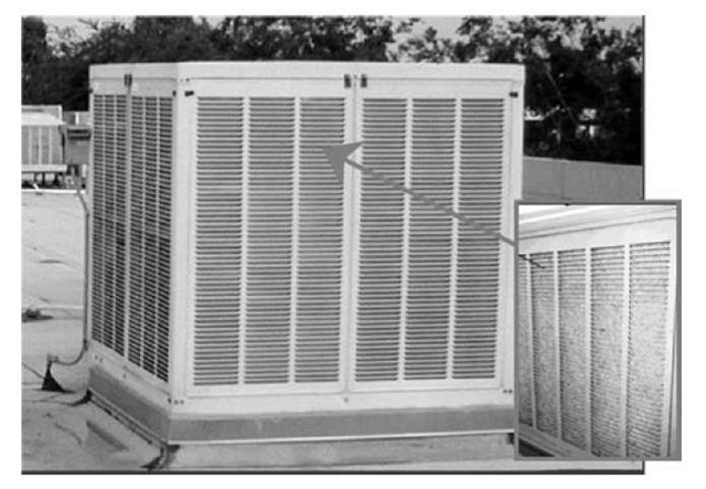Fiber pad evaporative cooler with aspen pads.