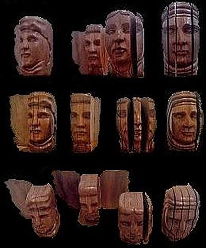 Cabeças esculpidas em madeira