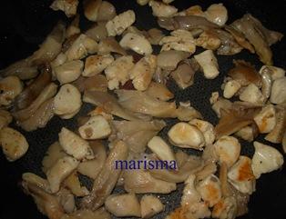 calabacines rellenos de champis,rehogando