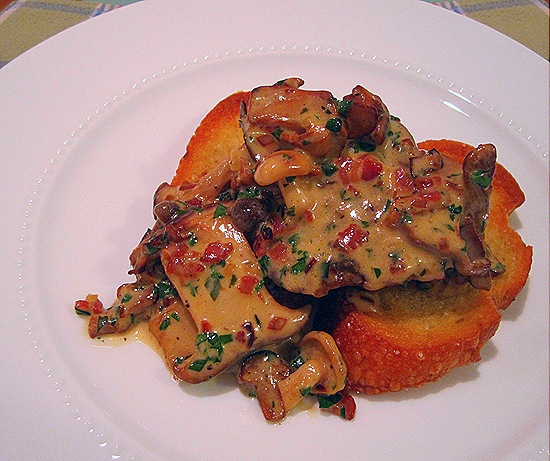 Sauteed Sweetbreads with Pancetta, Wild Mushrooms and Cream Over Grilled Bread