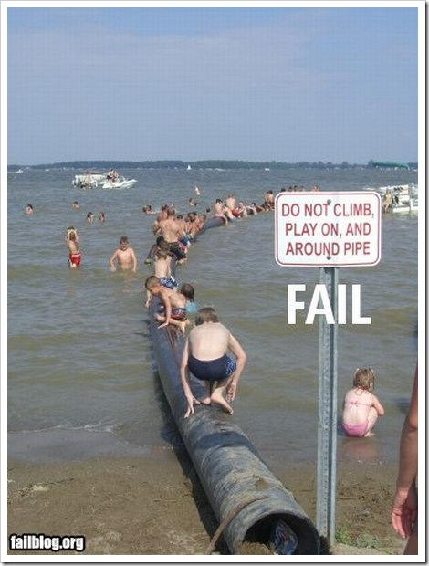 Funny beach sign fail.