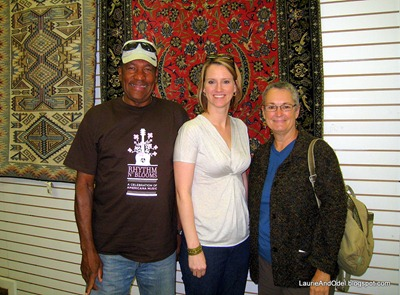 Odel, Brenda, and I in front of a rug display on the wall.