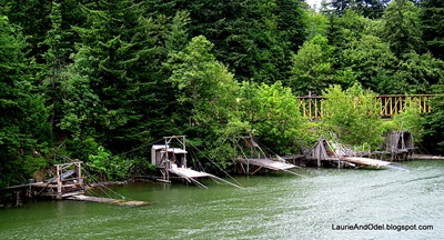 Native American fishing platforms on the Washington bank.  Four Indian tribes have year-round fishing rights in these traditional fishing grounds, where the rapids were flooded as water rose behind the dams.