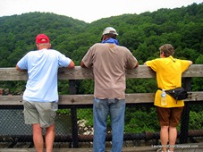 3 friends watching the rafters far below.