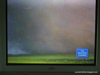 I took this picture of the Weather Channel the next morning, watching the news of the historic tornado outbtreak.