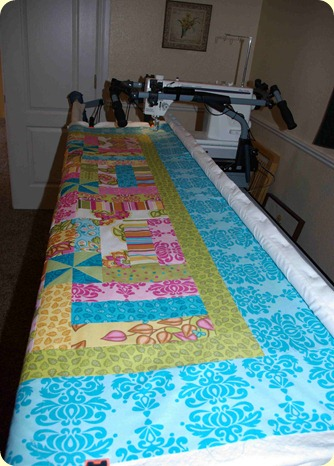 Soiree quilt on frame