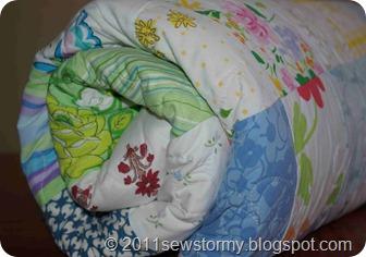 Vintage sheet quilt rolled