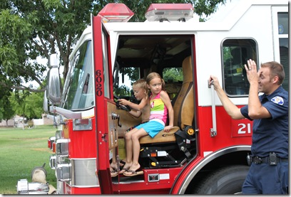 Gabe and emma firetruck 7-29-2010 9-56-09 AM