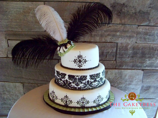 For the design of this three tier oval black damask pattern gave dramatic