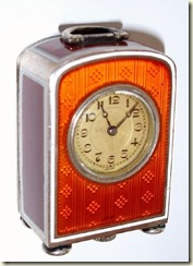 orange gullioche clock