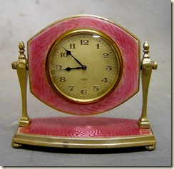 pink gullioche clock on stand