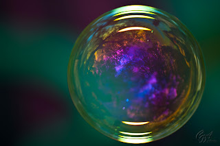 Colorful soap bubbles with reflections